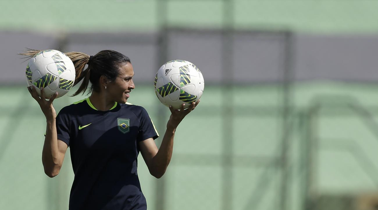 Brazil's Marta holds up two balls during a practice session a day before the women's Olympic semifinal soccer match between Brazil and Sweden, in Rio de Janeiro, Brazil, Monday, Aug. 15, 2016. (AP Photo/Leo Correa)