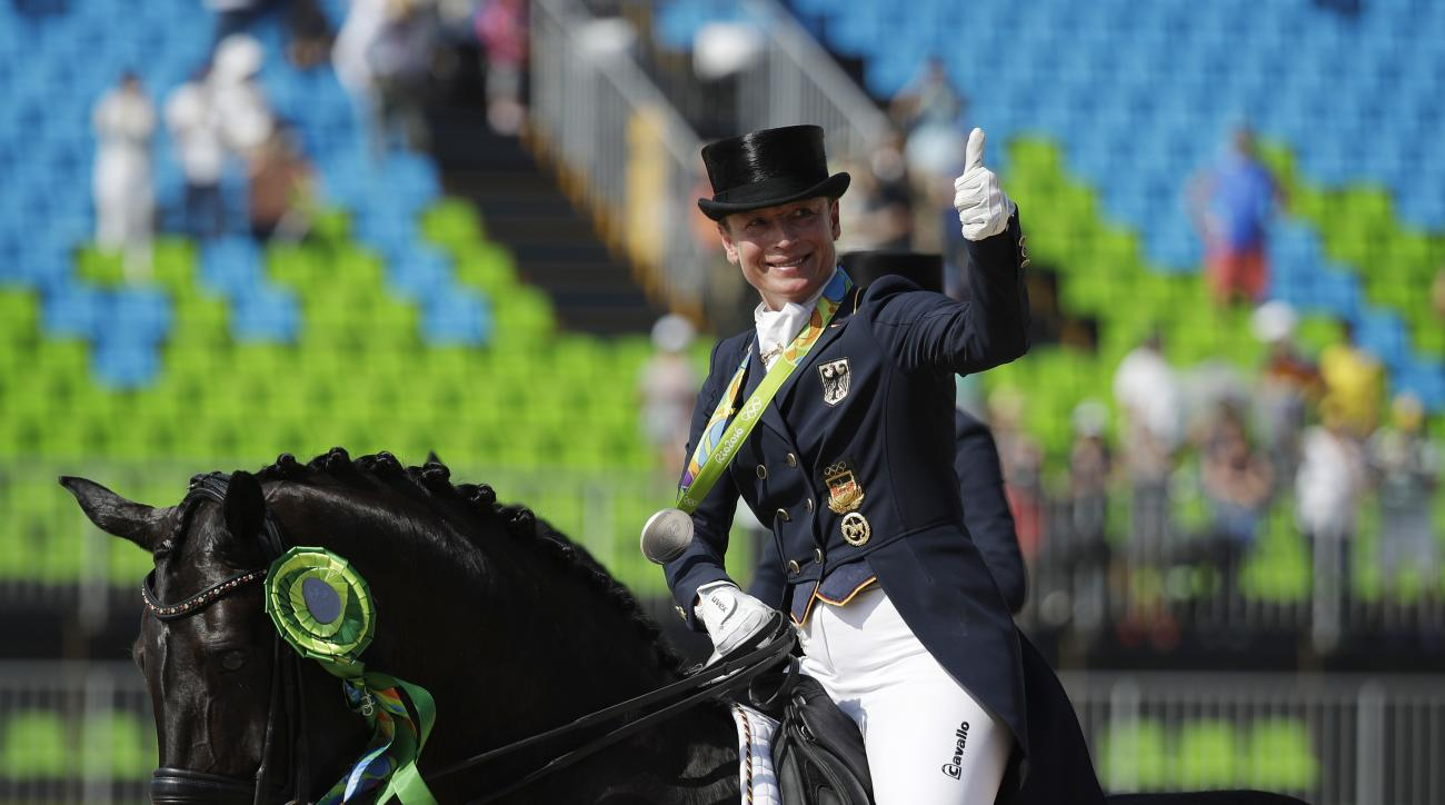 Germany's Isabell Werth, riding Weihegold Old, reacts after winning a silver medal in the equestrian dressage individual competition at the 2016 Summer Olympics in Rio de Janeiro, Brazil, Monday, Aug. 15, 2016. (AP Photo/John Locher)