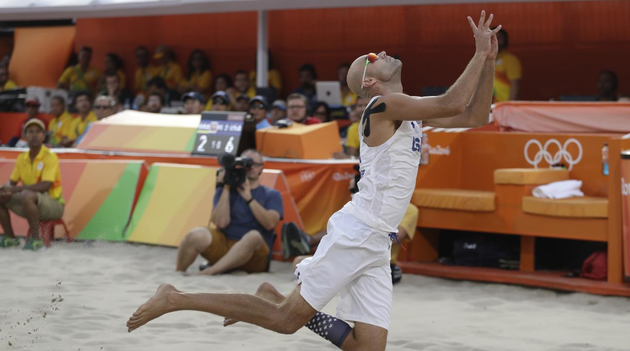 United States' Phil Dalhausser soars through the air after making a play on a ball during a men's beach volleyball quarterfinal match against Brazil at the 2016 Summer Olympics in Rio de Janeiro, Brazil, Monday, Aug. 15, 2016. (AP Photo/Petr David Josek)