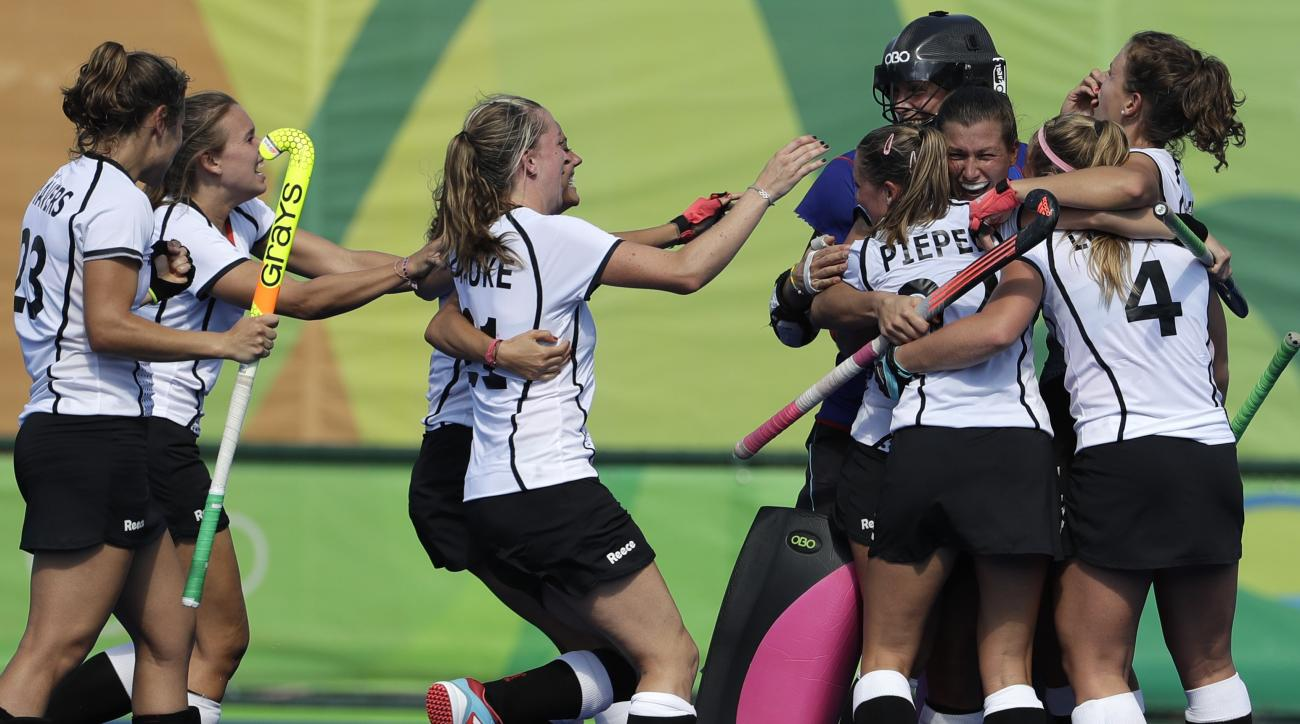 Germany players celebrate after they beat United States 2-1during a women's field hockey quarterfinal match at 2016 Summer Olympics in Rio de Janeiro, Brazil, Monday, Aug. 15, 2016. (AP Photo/Hussein Malla)