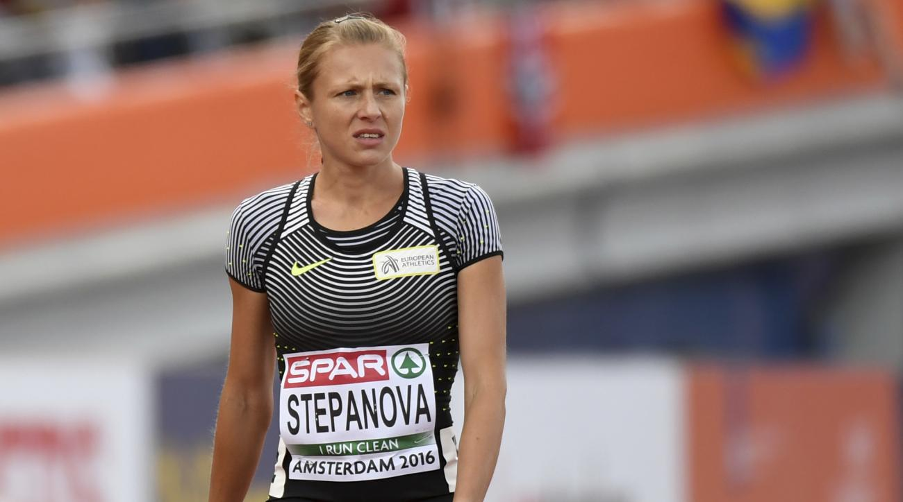 FILE - In this July 6, 2015 file photo Russian doping whistleblower Yuliya Stepanova, who ran under a neutral flag, leaves the track after suffering an injury in a women's 800m heat during the European Athletics Championships in Amsterdam, the Netherlands