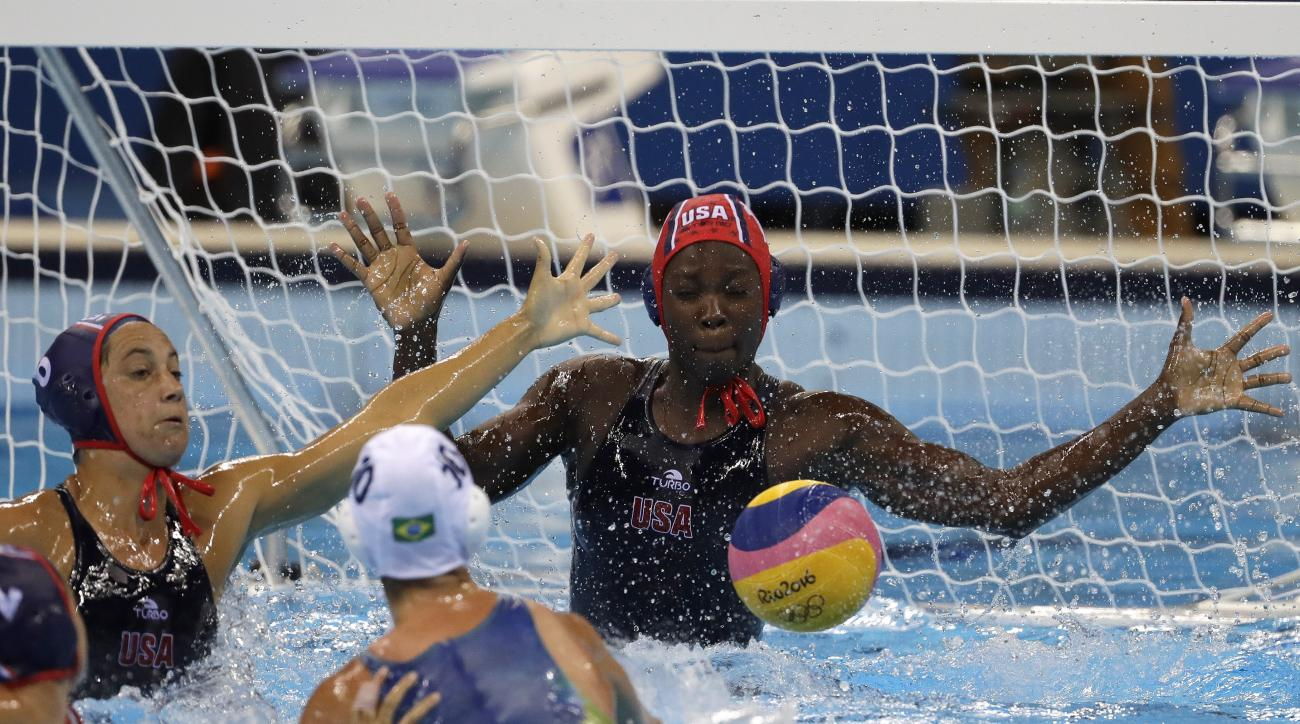 United States' Ashleigh Johnson makes a save during their women's water polo quarterfinal match against Brazil at the 2016 Summer Olympics in Rio de Janeiro, Brazil, Monday, Aug. 15, 2016. (AP Photo/Eduardo Verdugo)