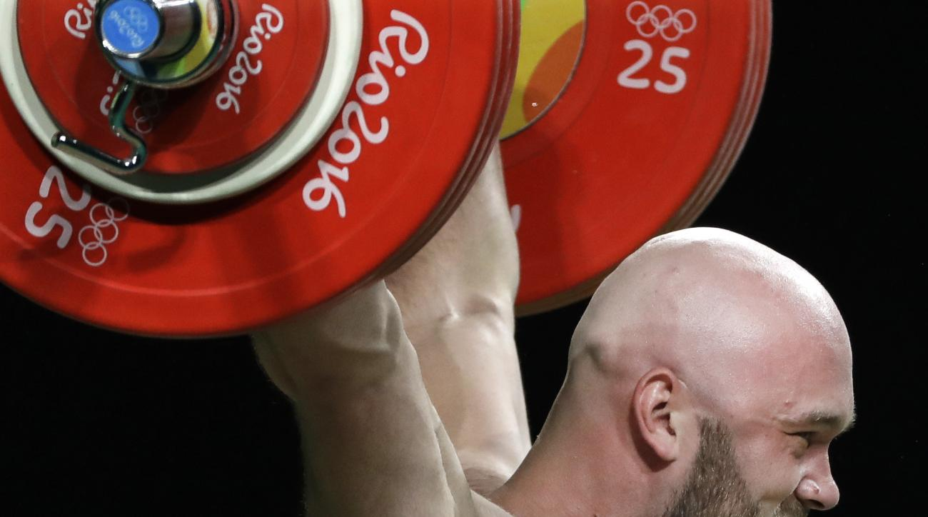 Ruslan Nurudinov, of Uzbekistan, competes in the men's 105 kg weightlifting event at the 2016 Summer Olympics in Rio de Janeiro, Brazil, Monday, Aug. 15, 2016. (AP Photo/Mike Groll)