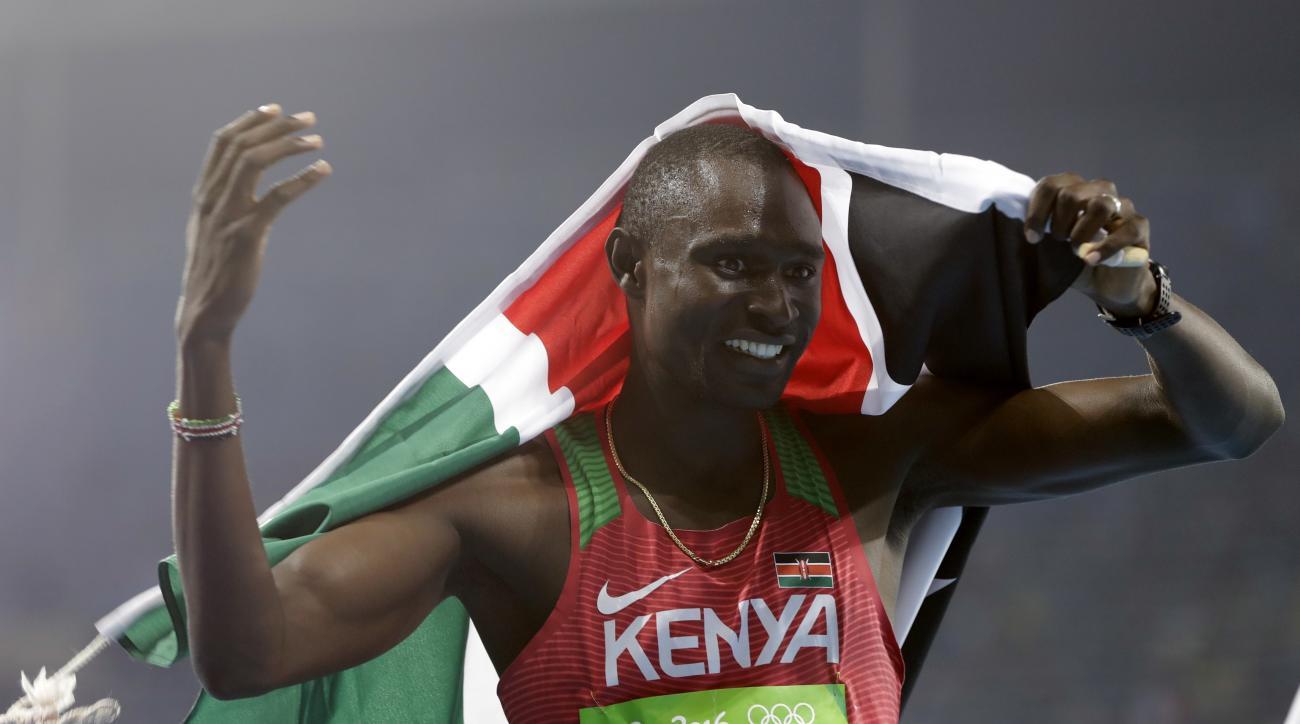 Kenya's David Lekuta Rudisha, left, celebrates winning the men's 800-meter final during the athletics competitions of the 2016 Summer Olympics at the Olympic stadium in Rio de Janeiro, Brazil, Monday, Aug. 15, 2016. (AP Photo/Natacha Pisarenko)