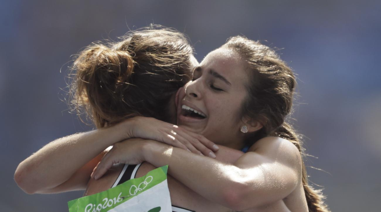 New Zealand's Nikki Hamblin, left, and United States' Abbey D'Agostino after competing in a women's 5000-meter heat during the athletics competitions of the 2016 Summer Olympics at the Olympic stadium in Rio de Janeiro, Brazil, Tuesday, Aug. 16, 2016. (AP