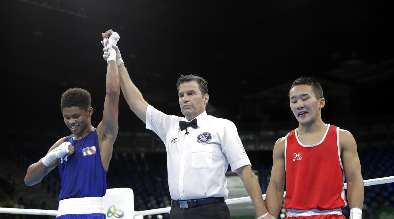 United States' Shakur Stevenson, left, reacts as he won a men's bantamweight 56-kg quarterfinals boxing match against Mongolia's Tsendbaatar Erdenebat at the 2016 Summer Olympics in Rio de Janeiro, Brazil, Tuesday, Aug. 16, 2016. (AP Photo/Jae C. Hong)