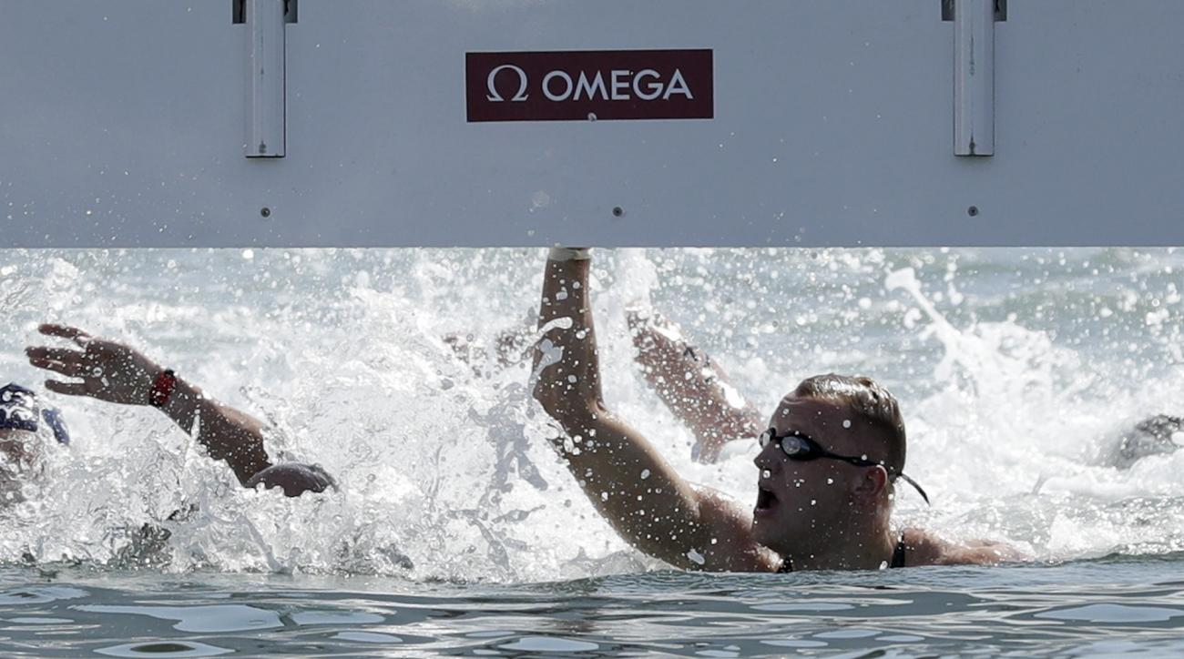 The Netherlands' Ferry Weertman wins the men's marathon swimming competition of the 2016 Summer Olympics in Rio de Janeiro, Brazil, Tuesday, Aug. 16, 2016. (AP Photo/Gregory Bull)
