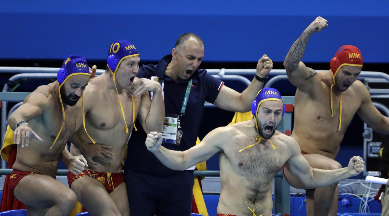 Montenegro players celebrate their victory after they defeated Hungary during their men's water polo quarterfinal match at the 2016 Summer Olympics in Rio de Janeiro, Brazil, Tuesday, Aug. 16, 2016. (AP Photo/Eduardo Verdugo)