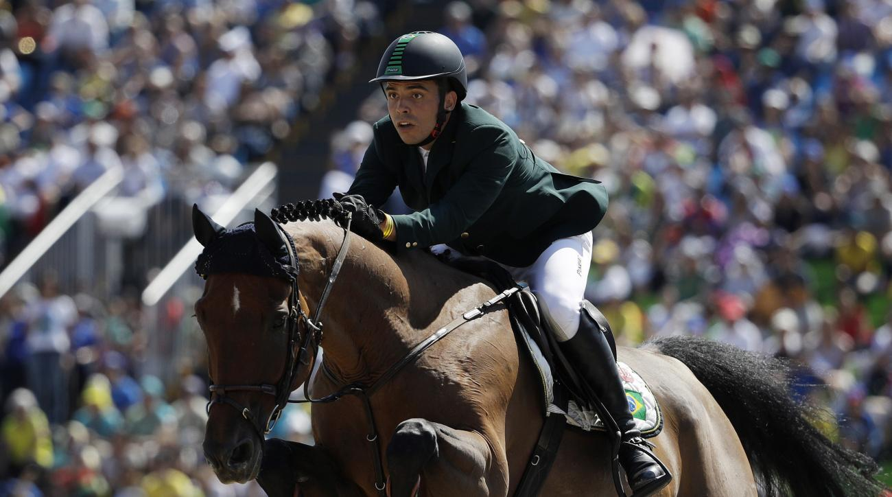 Brazil's Stephan de Freitas Barcha, riding Landpeter Do Feroleto, competes in the equestrian jumping competition at the 2016 Summer Olympics in Rio de Janeiro, Brazil, Tuesday, Aug. 16, 2016. (AP Photo/John Locher)