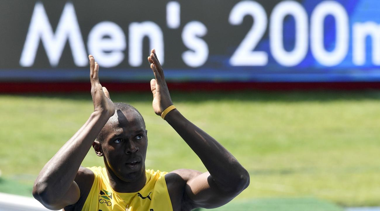 Jamaica's Usain Bolt celebrates winning the men's 200-meter heat during the athletics competitions of the 2016 Summer Olympics at the Olympic stadium in Rio de Janeiro, Brazil, Tuesday, Aug. 16, 2016. (AP Photo/Martin Meissner)