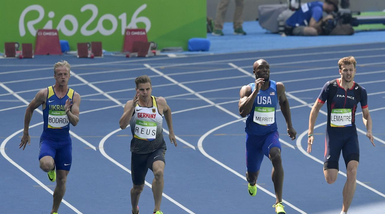 From left, Ukraine's Ihor Bodrov, Germany's Julian Reus, United States' Lashawn Merritt and France's Christophe Lemaitre compete in a men's 200-meter heat during the athletics competitions of the 2016 Summer Olympics at the Olympic stadium in Rio de Janei