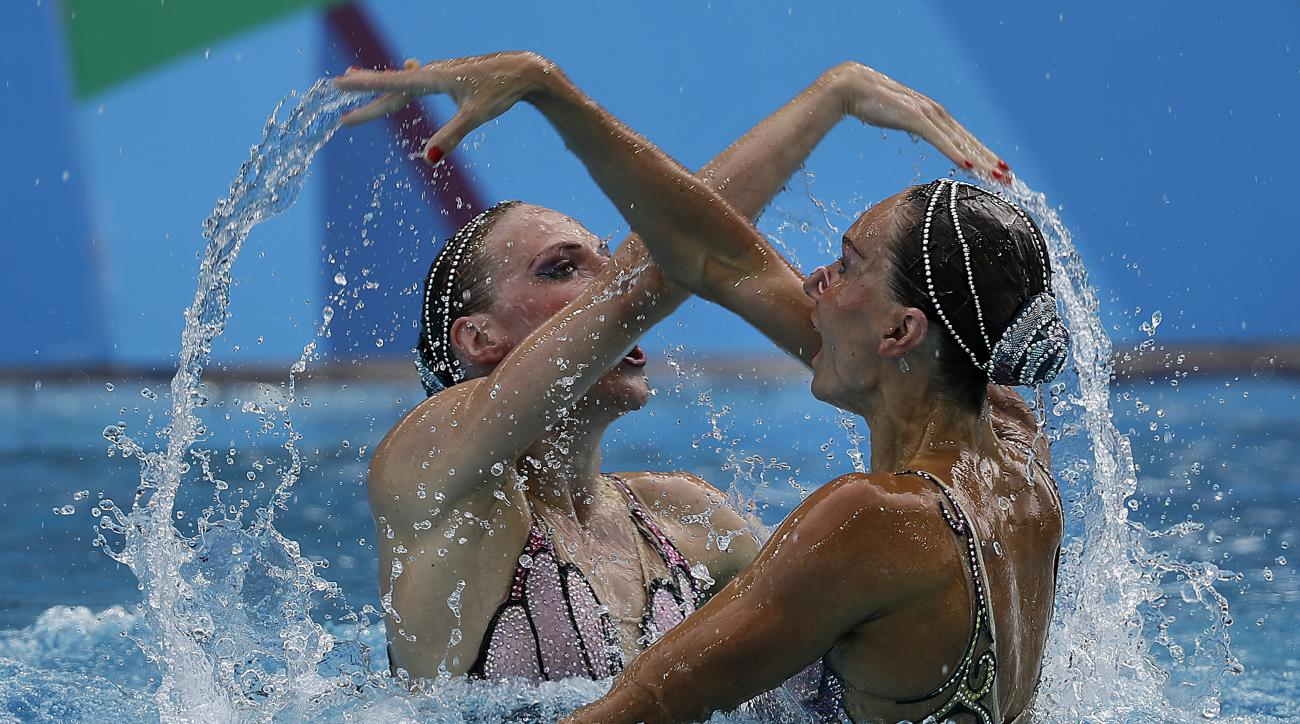 Russia's Natalia Ishchenko and Svetlana Romashina compete during the synchronized swimming duet free routine final in the Maria Lenk Aquatic Center at the 2016 Summer Olympics in Rio de Janeiro, Brazil, Tuesday, Aug. 16, 2016. (AP Photo/Wong Maye-E)