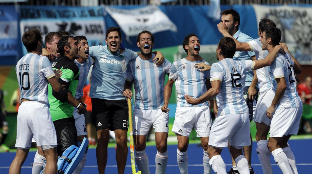 Argentina fans cheer during a men's field hockey semifinal match against Germany at 2016 Summer Olympics in Rio de Janeiro, Brazil, Tuesday, Aug. 16, 2016. (AP Photo/Hussein Malla)