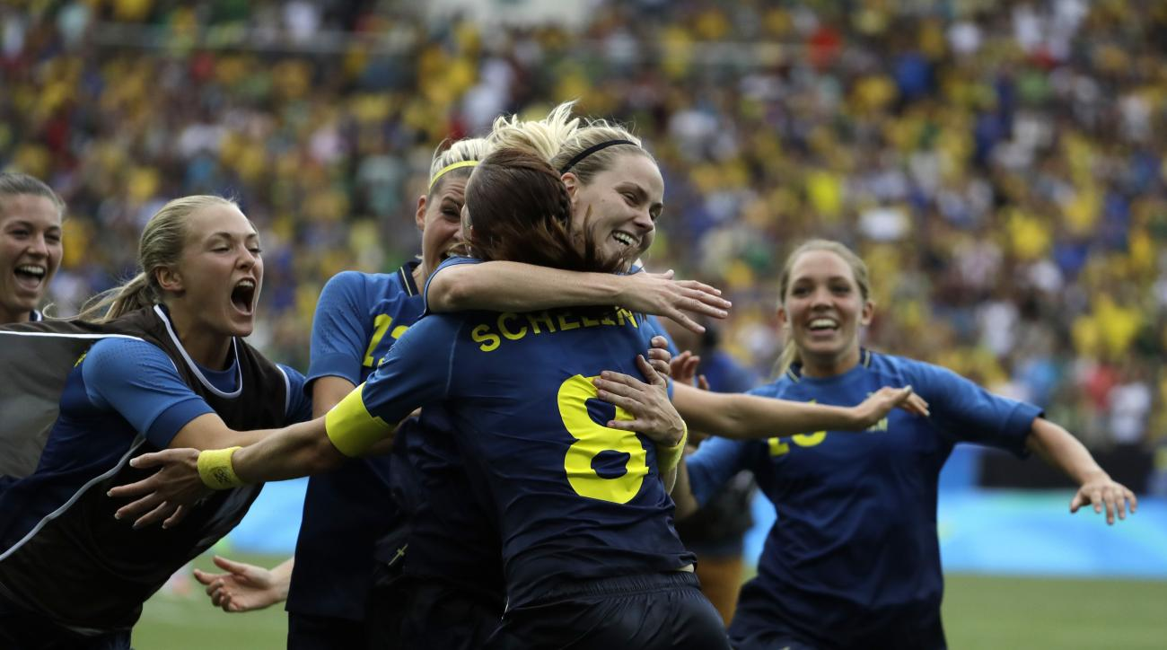 Sweden's players celebrate after the penalty kicks during a semi-final match of the women's Olympic football tournament between Brazil and Sweden at the Maracana stadium in Rio de Janeiro Tuesday Aug. 16, 2016. Sweden qualified for the final after beating