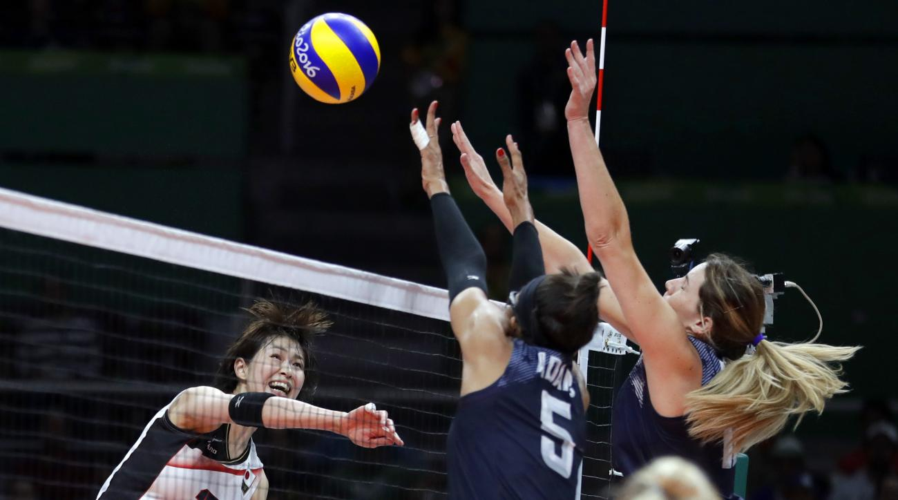 Japan's Saori Kimura, left, has a spike blocked by United States' Rachael Adams (5) and Kelly Murphy, right, during a women's quarterfinal volleyball match at the 2016 Summer Olympics in Rio de Janeiro, Brazil, Tuesday, Aug. 16, 2016. (AP Photo/Jeff Rober