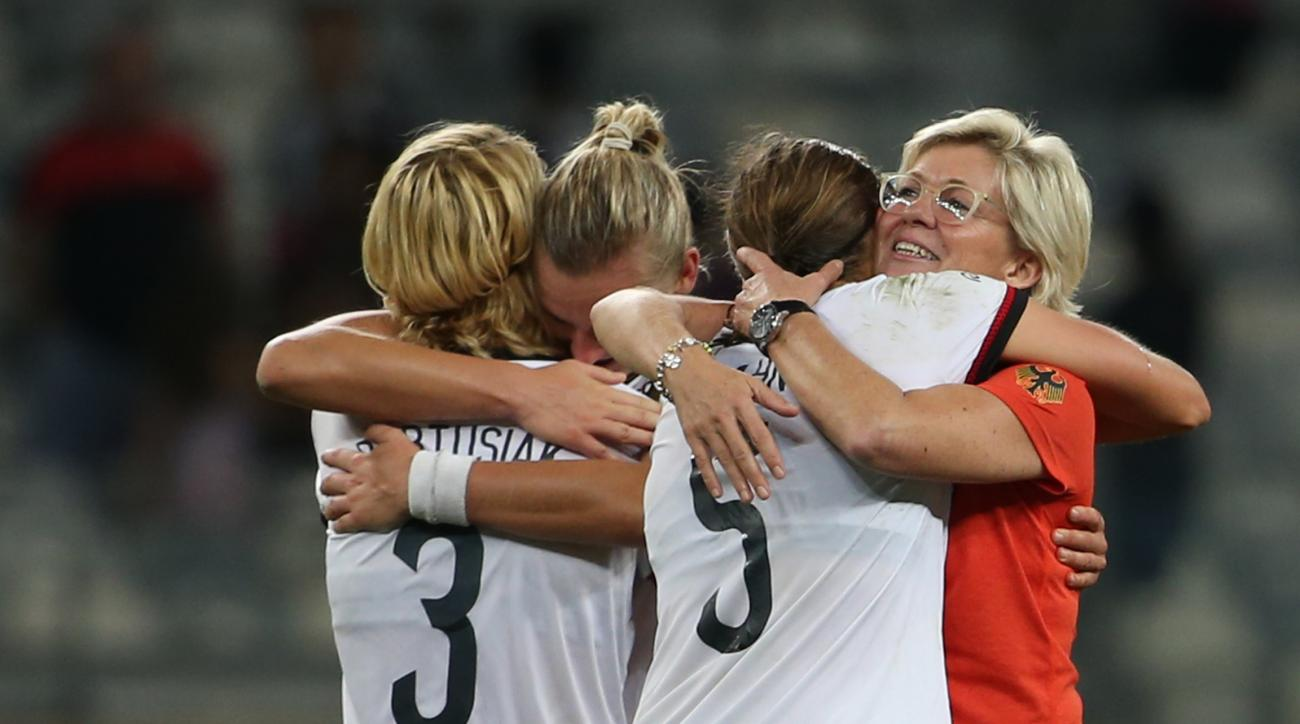 Germany coach Silvia Neid, right, embraces Annike Krahn at the end of a semi-final match of the women's Olympic football tournament between Canada and Germany at the Mineirao stadium in Belo Horizonte, Brazil, Tuesday Aug. 16, 2016. Germany won 2-0 and qu