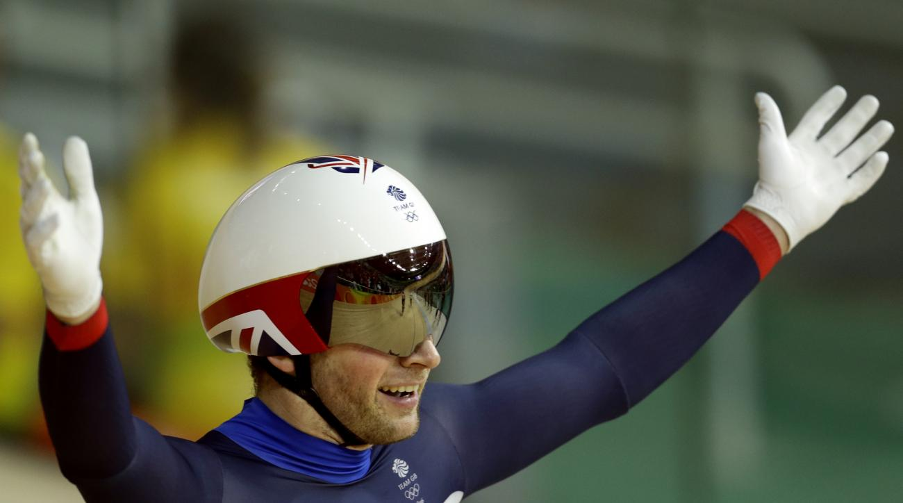 Jason Kenny of Britain celebrates after winning gold the men's keirin cycling final at the Rio Olympic Velodrome during the 2016 Summer Olympics in Rio de Janeiro, Brazil, Tuesday, Aug. 16, 2016. (AP Photo/Victor R. Caivano)