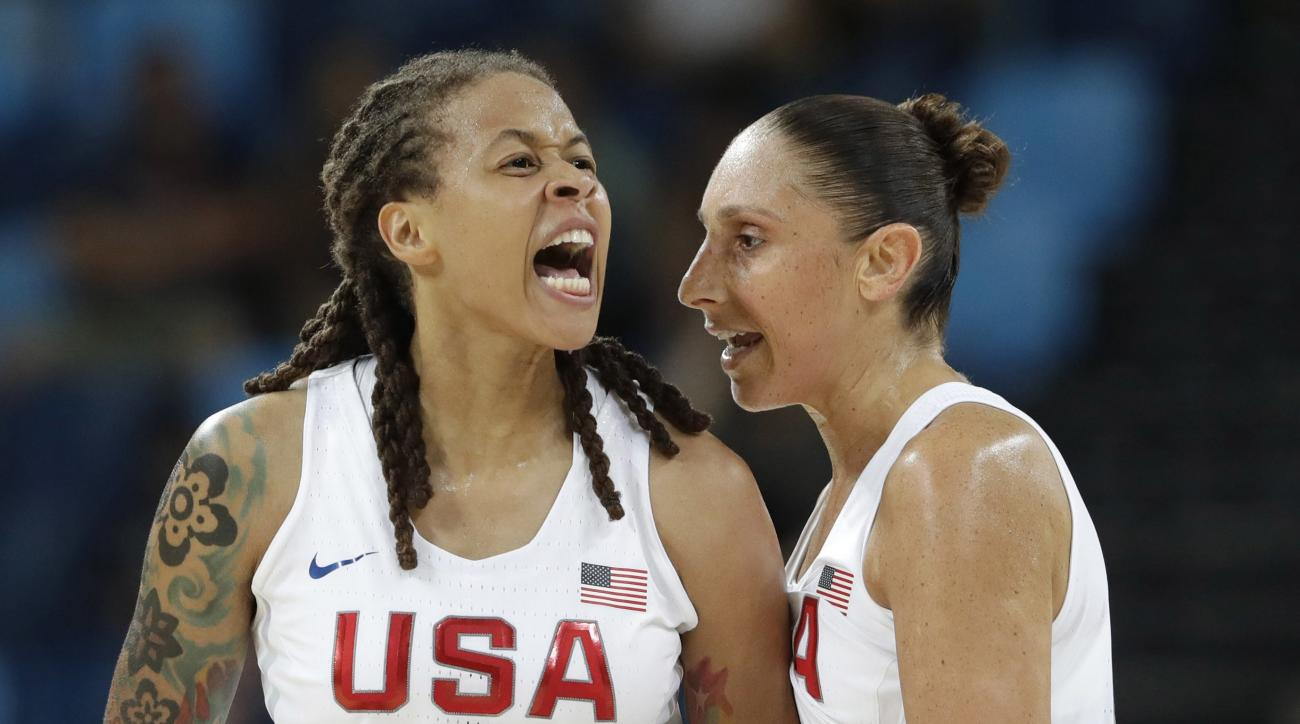 United States' Seimone Augustus (5), with teammate Diana Taurasi, reacts to a score against Japan during a women's quarterfinal round basketball game at the 2016 Summer Olympics in Rio de Janeiro, Brazil, Tuesday, Aug. 16, 2016. (AP Photo/Eric Gay)