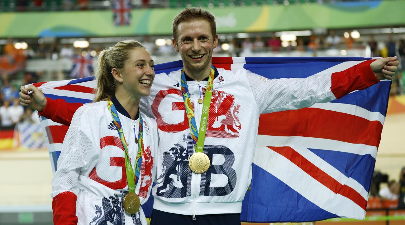 Laura Trott, left, and her fiance Jason Kenny, right, both of Britain, pose with their gold medals at the Rio Olympic Velodrome during the 2016 Summer Olympics in Rio de Janeiro, Brazil, Tuesday, Aug. 16, 2016. Kenny won the men's keirin cycling final and