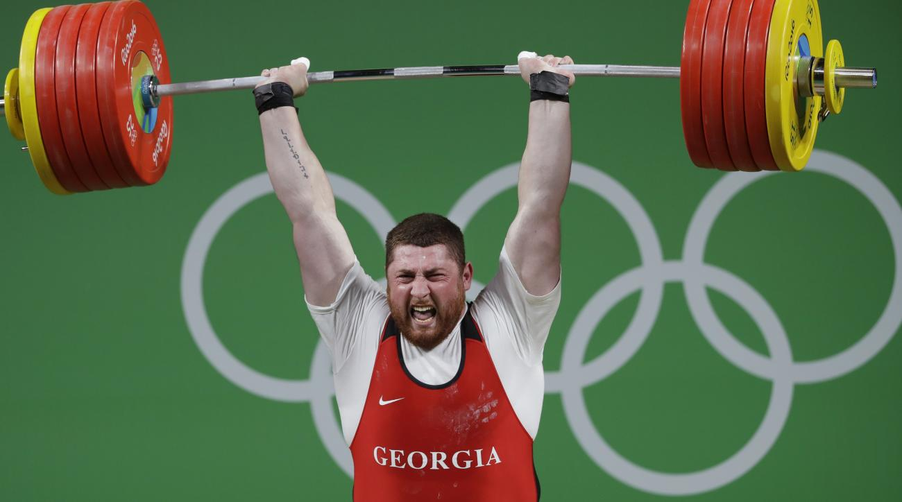 Lasha Talakhadze, of Georgia, competes in the men's +105 kg weightlifting event at the 2016 Summer Olympics in Rio de Janeiro, Brazil, Tuesday, Aug. 16, 2016. Talakhadze won the gold medal. (AP Photo/Mike Groll)