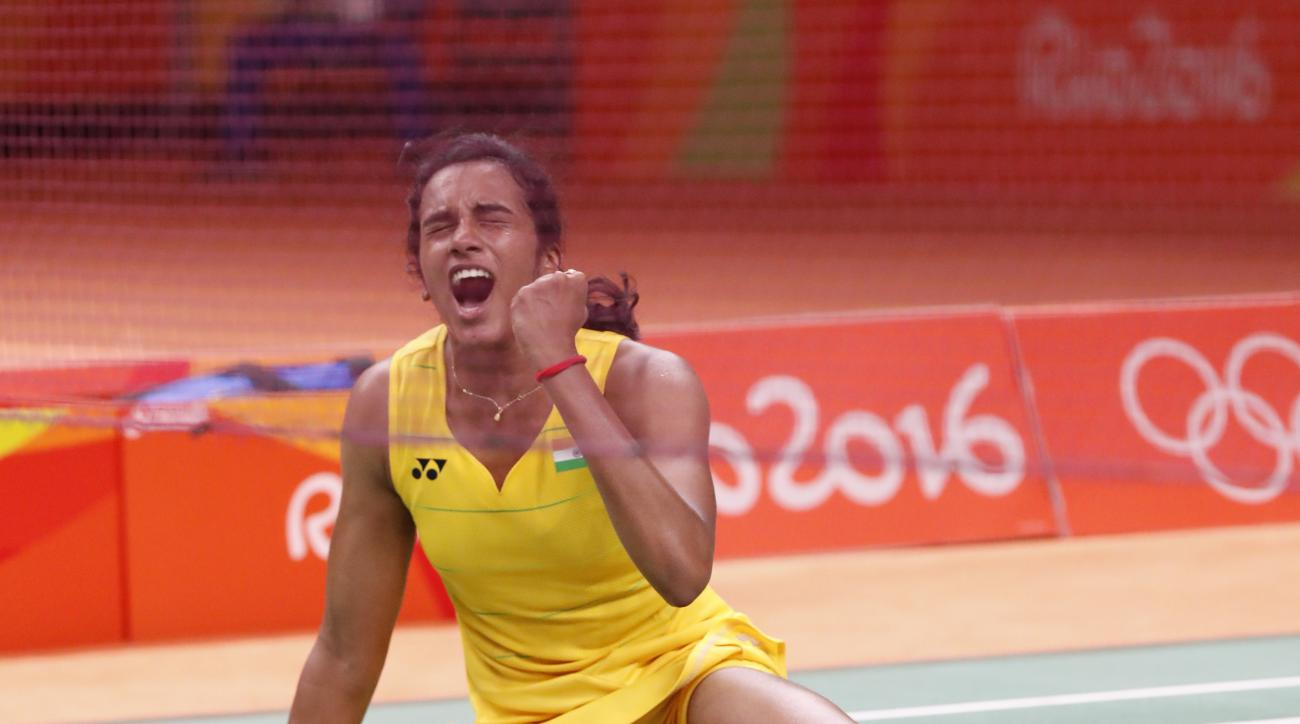 India's Sindhu Pusarla reacts after winning China's Wang Yihan during the Women's Singles Quarterfinal at the 2016 Summer Olympics in Rio de Janeiro, Brazil, Tuesday, Aug. 16, 2016. (AP Photo/Vincent Thian)