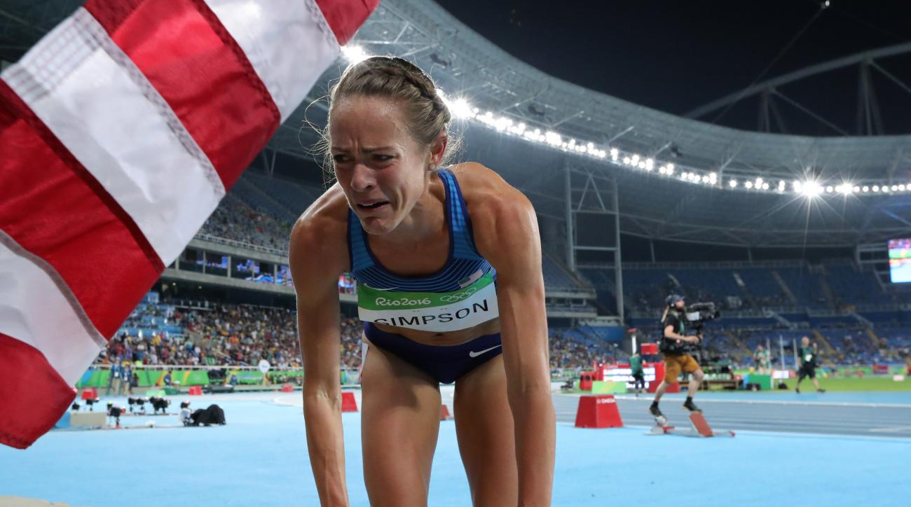 United States' Jennifer Simpson cries after taking the bronze medal in the women's 1500-meter final during the athletics competitions of the 2016 Summer Olympics at the Olympic stadium in Rio de Janeiro, Brazil, Tuesday, Aug. 16, 2016. (AP Photo/Lee Jin-m