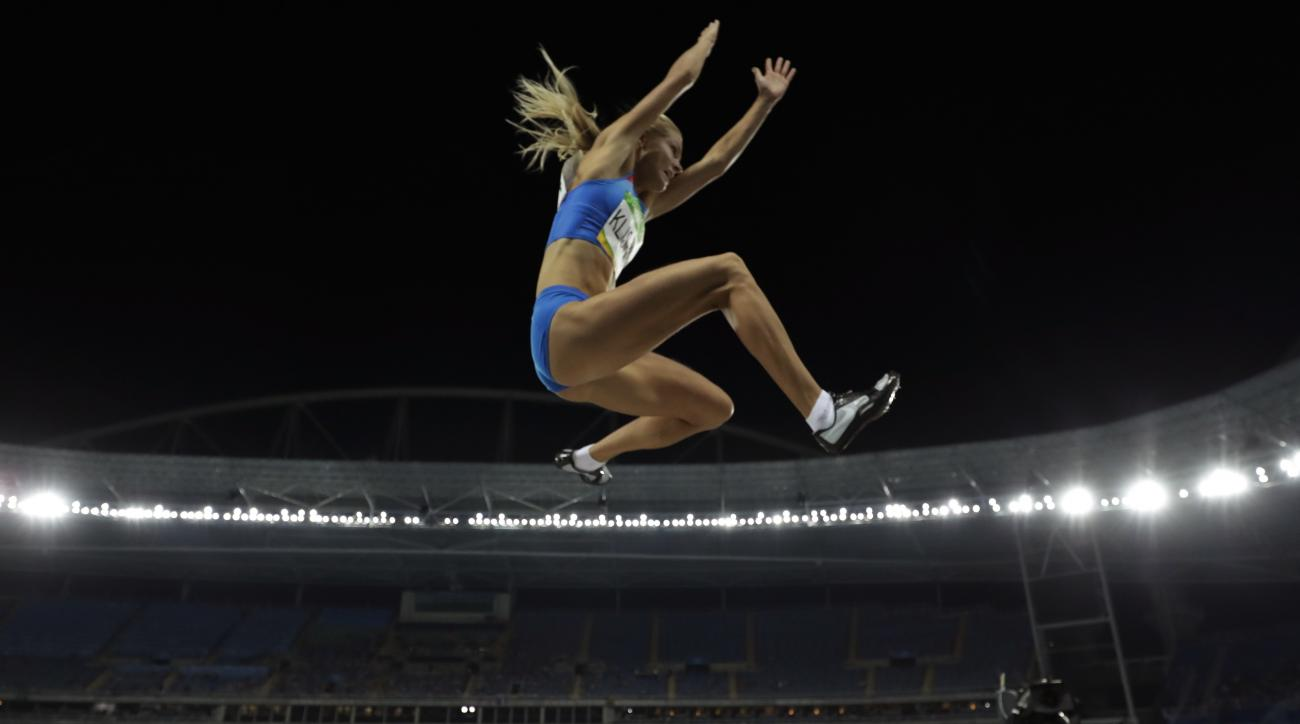 Russia's Darya Klishina competes in the women's long jump qualification, during the athletics competitions of the 2016 Summer Olympics at the Olympic stadium in Rio de Janeiro, Brazil, Tuesday, Aug. 16, 2016. (AP Photo/Matt Slocum)