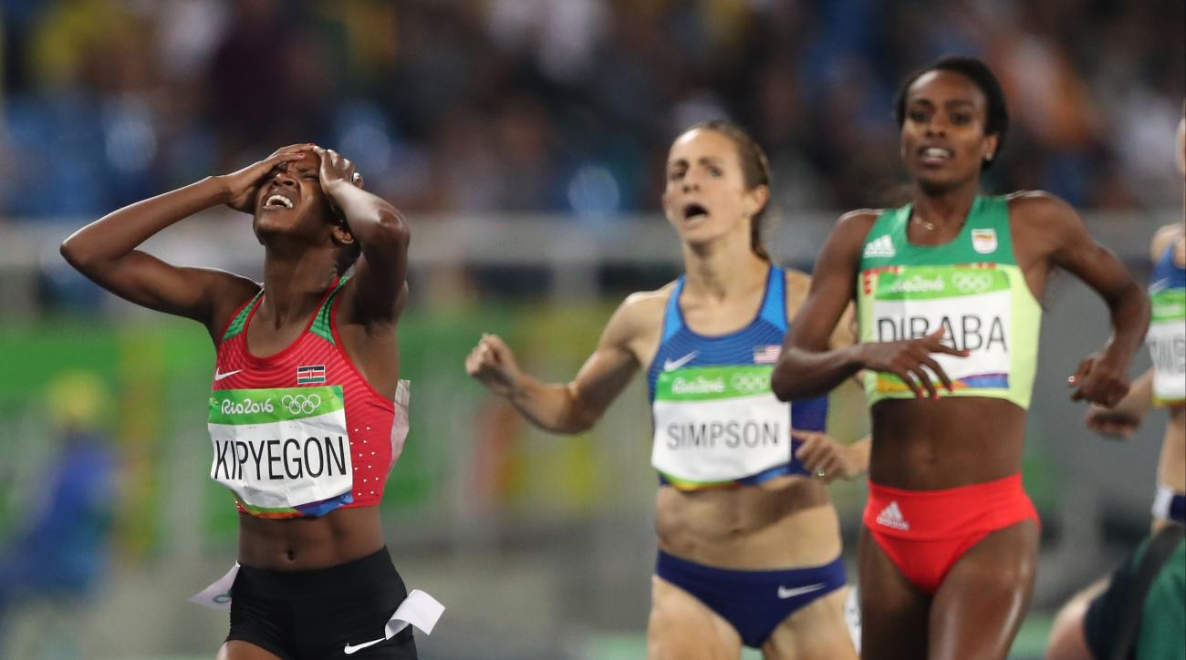 Kenya's Faith gold medal winner Chepngetich Kipyegon, left, United States' bronze medal winner Jennifer Simpson and Ethiopia's silver medal winner Genzebe Dibaba, right, after the women's 1500-meter final during the athletics competitions of the 2016 Summ