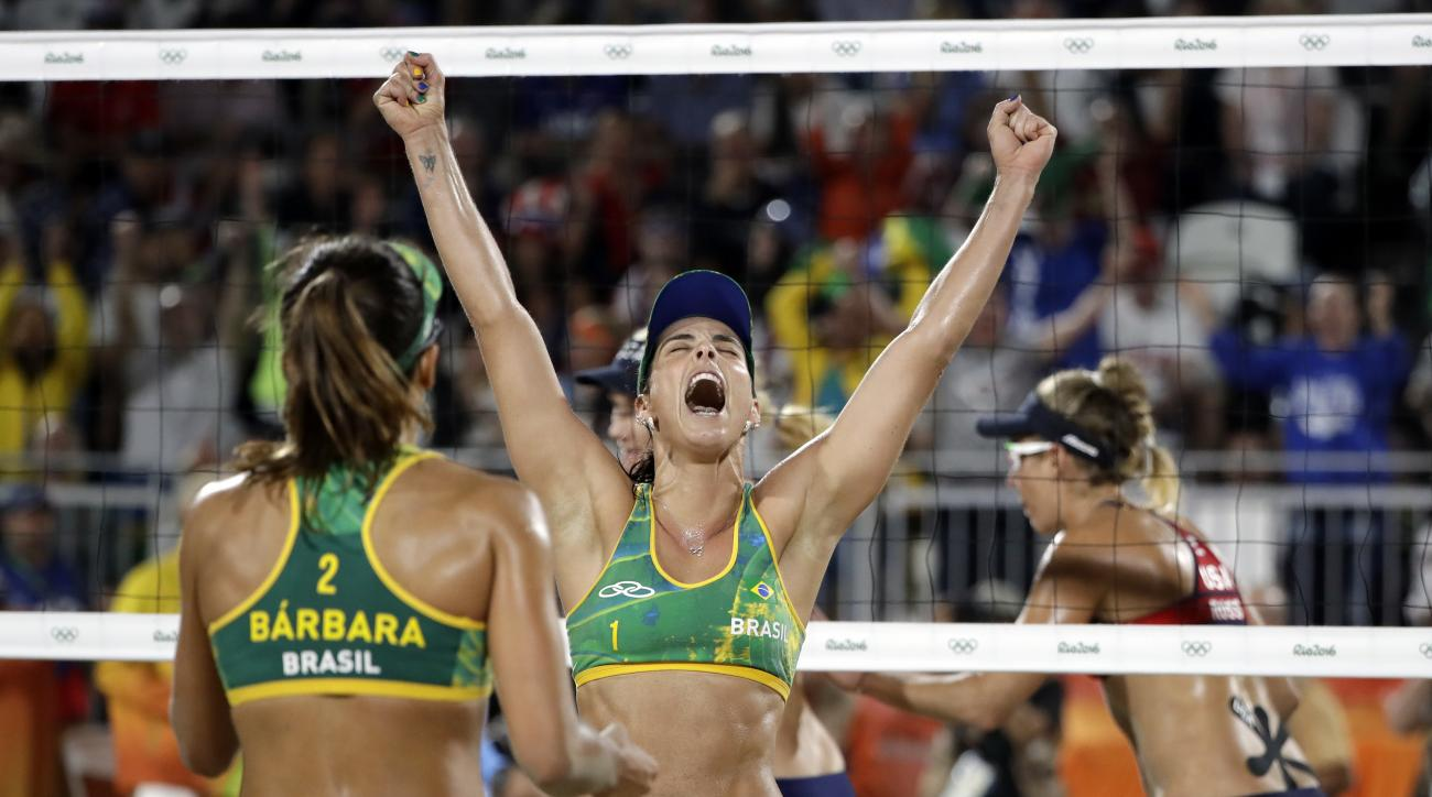 Brazil's Agatha Bednarczuk, center, celebrates a point against the United States with teammate Barbara Seixas de Freitas during a women's beach volleyball semifinal match at the 2016 Summer Olympics in Rio de Janeiro, Brazil, Wednesday, Aug. 17, 2016. (AP