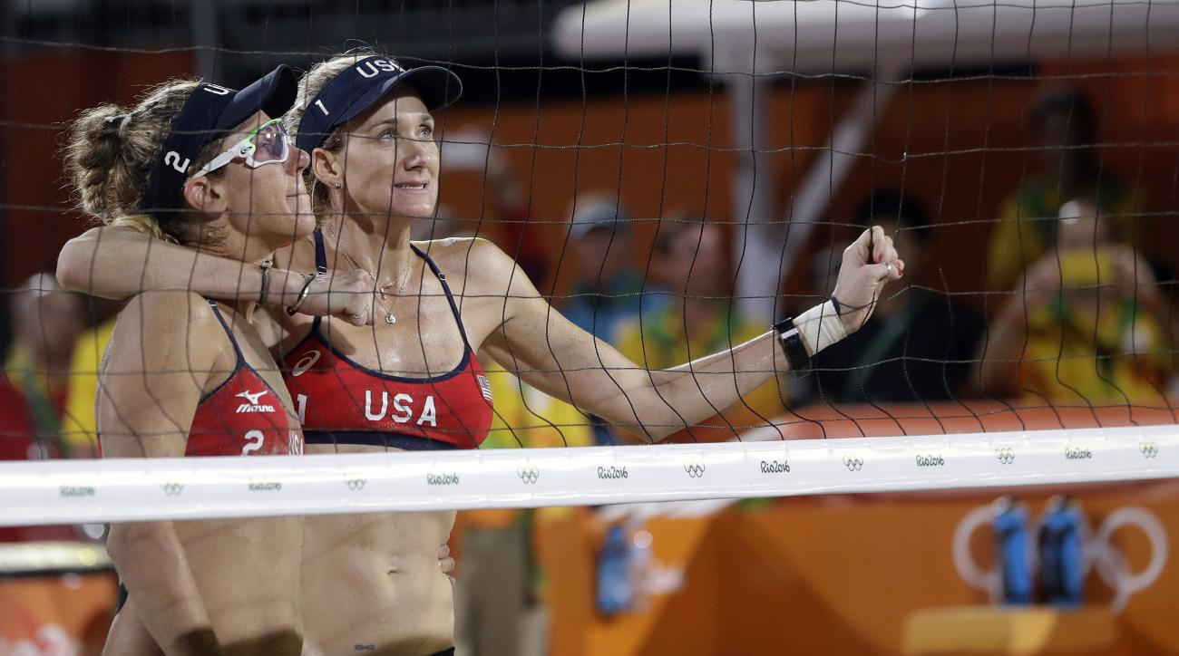 United States' Kerri Walsh Jennings, right, and April Ross stand at the net after losing to Brazil during a women's beach volleyball semifinal match at the 2016 Summer Olympics in Rio de Janeiro, Brazil, Wednesday, Aug. 17, 2016. (AP Photo/Marcio Jose San