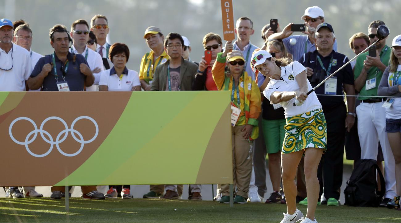 Miriam Nagl of Brazil, hits the opening tee shot on the 1st hole during the first round of the women's golf event at the 2016 Summer Olympics in Rio de Janeiro, Brazil, Wednesday, Aug. 17, 2016. (AP Photo/Alastair Grant)