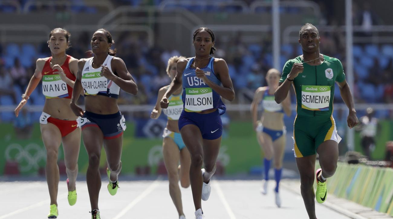 South Africa's Caster Semenya, right, United States' Ajee Wilson, center, Britain's Shelayna Oskan-Clarke, second left, and China's Chunyu Wang, left, compete in a women's 800-meter heat during the athletics competitions of the 2016 Summer Olympics at the