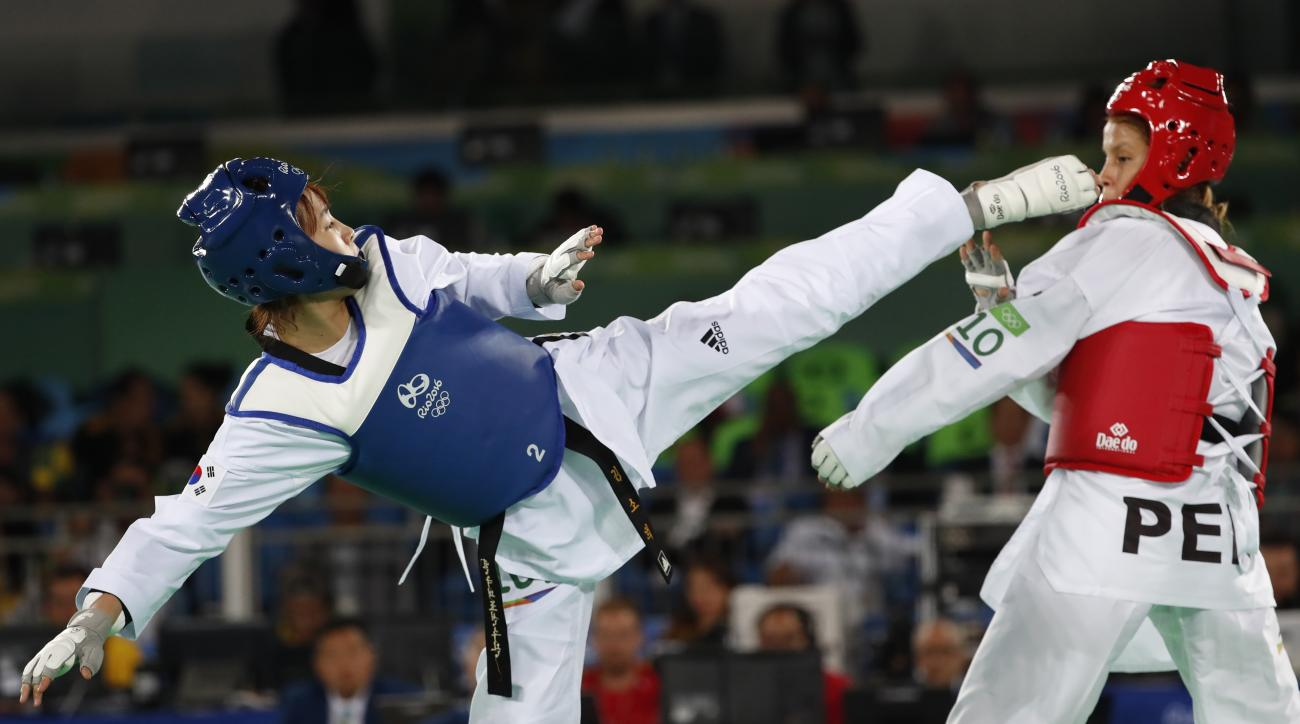 Kim Sohui from South Korea, left, and Julissa Diez Canseco from Peru compete in women's -49kg Taekwondo match at the 2016 Summer Olympics in Rio de Janeiro, Brazil, Wednesday, Aug. 17, 2016. (AP Photo/Vincent Thian)
