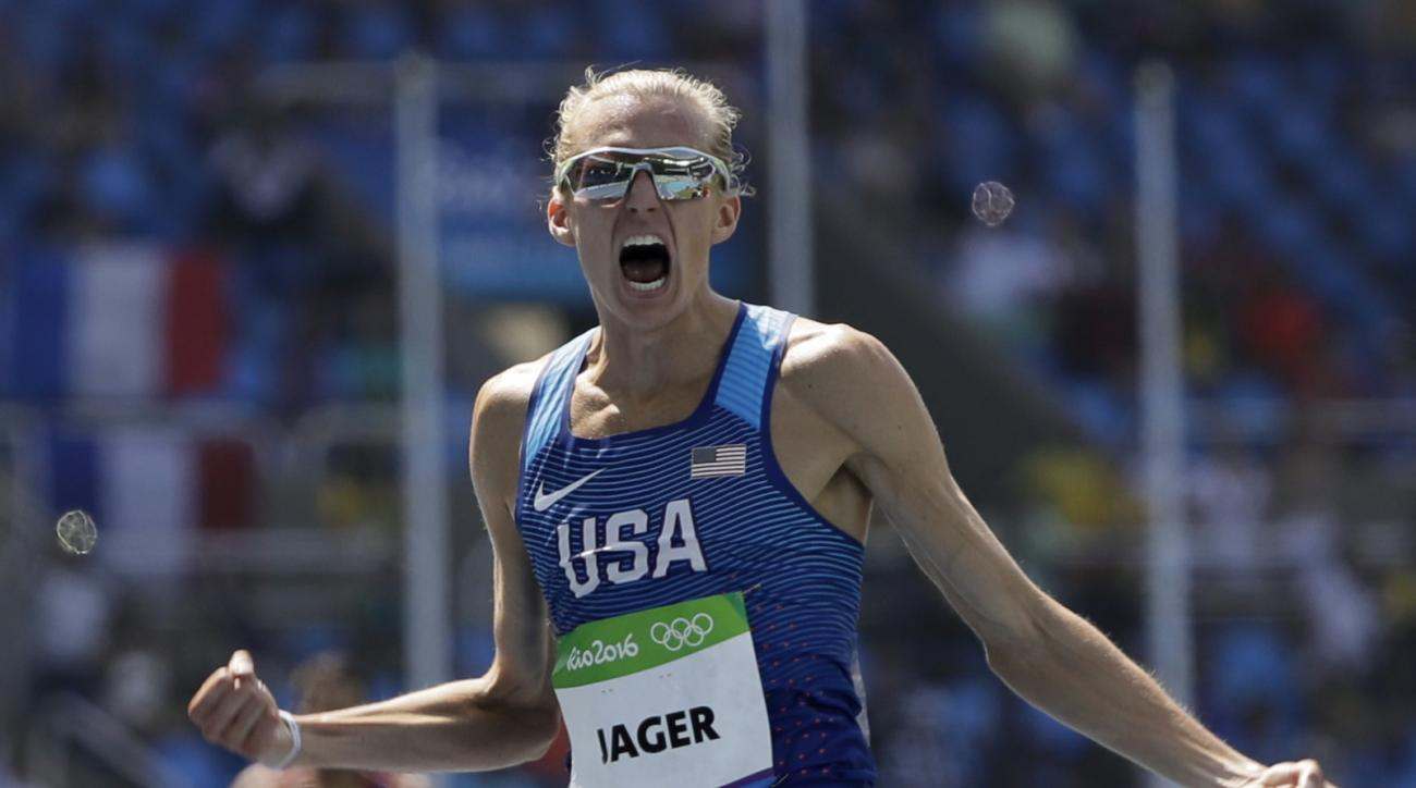 United States' Evan Jager wins the silver medal in the men's 3000-meter steeplechase final during the athletics competitions of the 2016 Summer Olympics at the Olympic stadium in Rio de Janeiro, Brazil, Wednesday, Aug. 17, 2016. (AP Photo/David J. Phillip