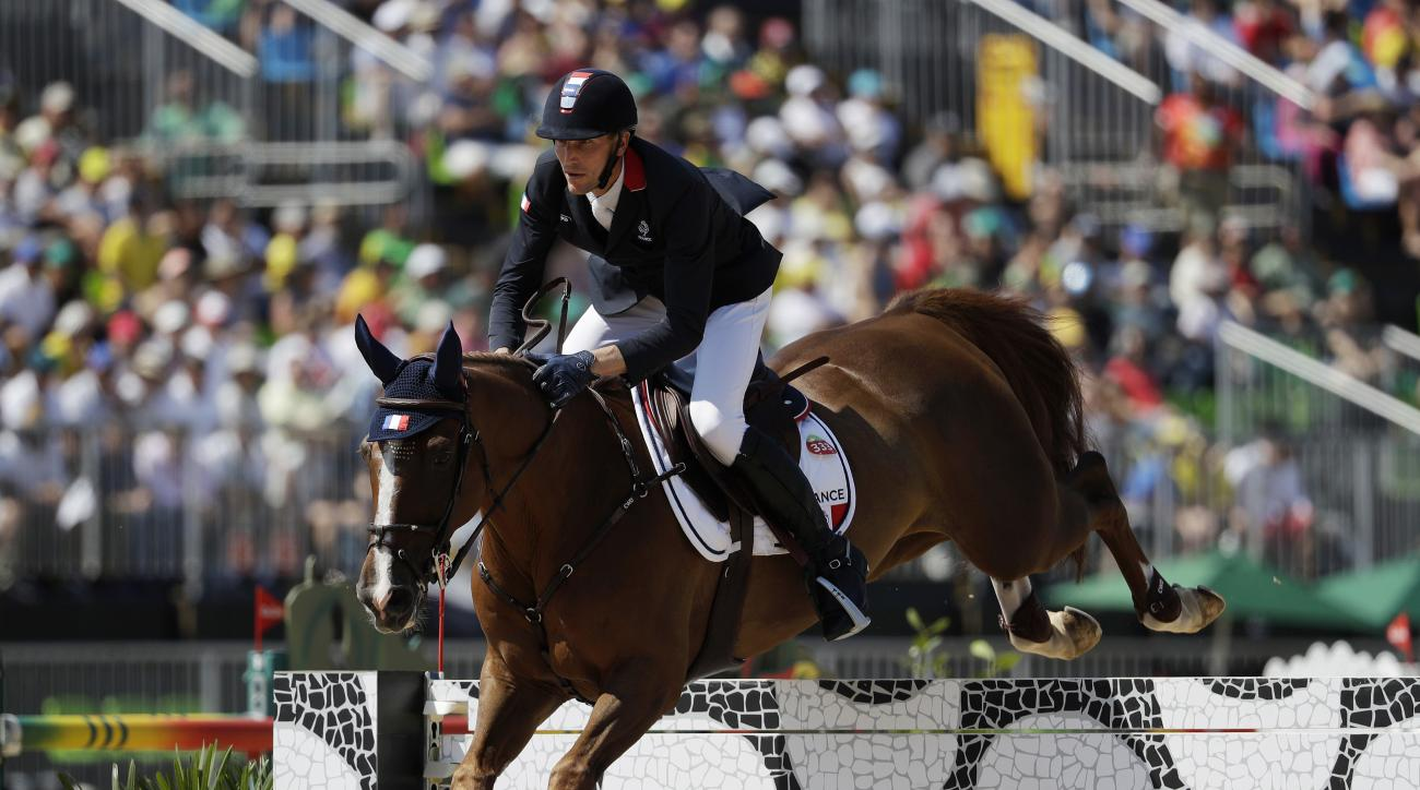 France's Kevin Staut, riding Reveur De Hurtebise, competes in the equestrian jumping competition at the 2016 Summer Olympics in Rio de Janeiro, Brazil, Wednesday, Aug. 17, 2016. (AP Photo/John Locher)