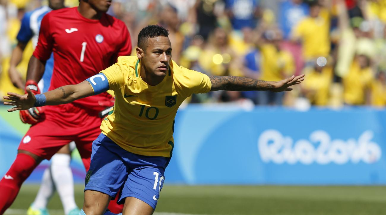 Brazil's Neymar celebrates after his side's first goal during a semifinal match of the men's Olympic football tournament against Honduras at the Maracana stadium in Rio de Janeiro, Brazil, Wednesday Aug. 17, 2016. Neymar scored just 15 seconds into the ga