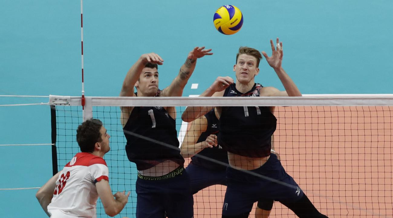United States' Matthew Anderson, left, and Maxwell Holt go up to block a shot by Poland's Mateusz Mika in a men's quarterfinal volleyball match at the 2016 Summer Olympics in Rio de Janeiro, Brazil, Wednesday, Aug. 17, 2016. (AP Photo/Robert F. Bukaty)