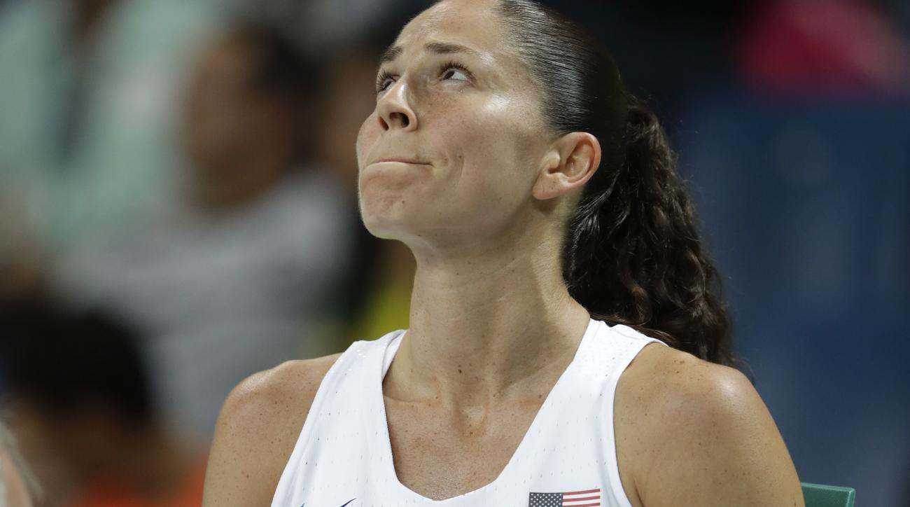 United States' Sue Bird sits on the bench after a fall during a women's quarterfinal round basketball game against Japan at the 2016 Summer Olympics in Rio de Janeiro, Brazil, Tuesday, Aug. 16, 2016. (AP Photo/Eric Gay)