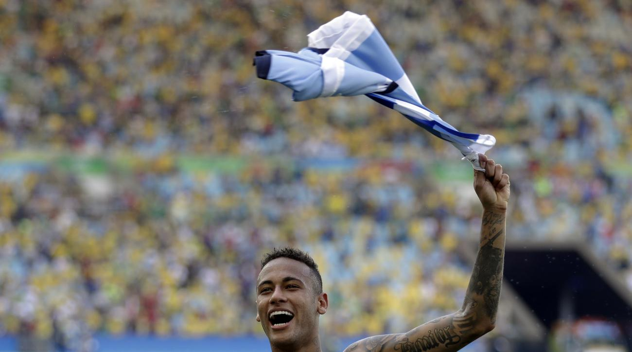 Brazil's Neymar celebrates at the end of a semifinal match of the men's Olympic football tournament between Brazil and Honduras at the Maracana stadium in Rio de Janeiro Wednesday Aug. 17, 2016. Brazil won the match 6-0 and qualified for the final.(AP Pho
