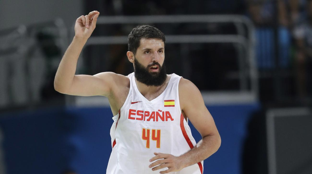 Spain's Nikola Mirotic (44) signals after a score against Argentina during a men's basketball game at the 2016 Summer Olympics in Rio de Janeiro, Brazil, Monday, Aug. 15, 2016. (AP Photo/Eric Gay)