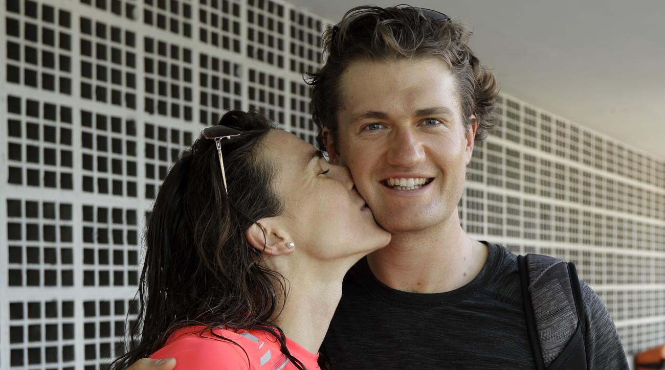"""Gwen Jorgensen, of the United States, kisses her husband Patrick Lemieux after training for the upcoming women's triathlon of the Summer Olympics in Rio de Janeiro, Brazil, Wednesday, Aug. 17, 2016. """"Patrick is vital to my success,"""" said Jorgensen, the tw"""