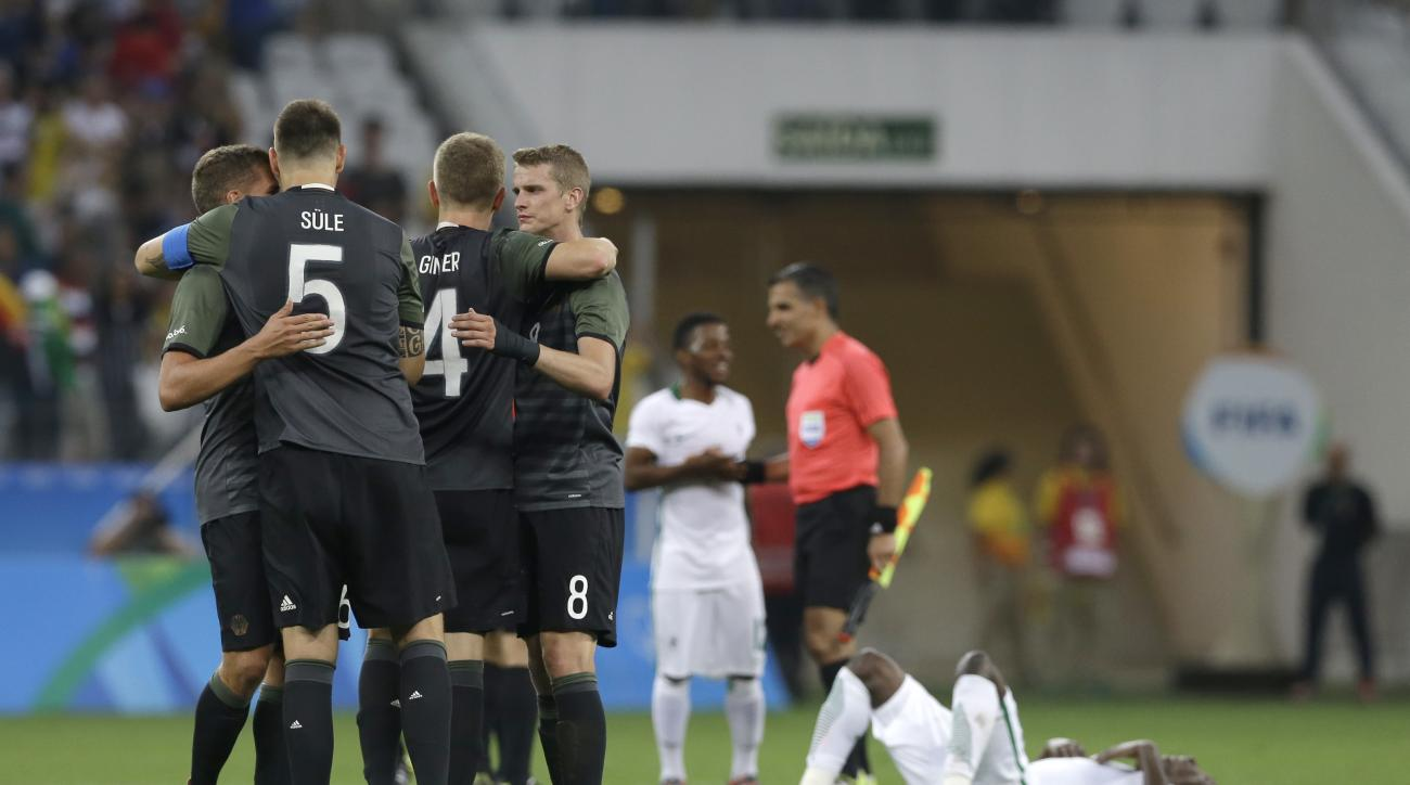 Germany's players celebrate at the end of a semi-final match of the men's Olympic football tournament between Germany and Nigeria in Sao Paulo, Wednesday Aug. 17, 2016. Germany won 2-0 and will play the final against Brazil.(AP Photo/Leo Correa)