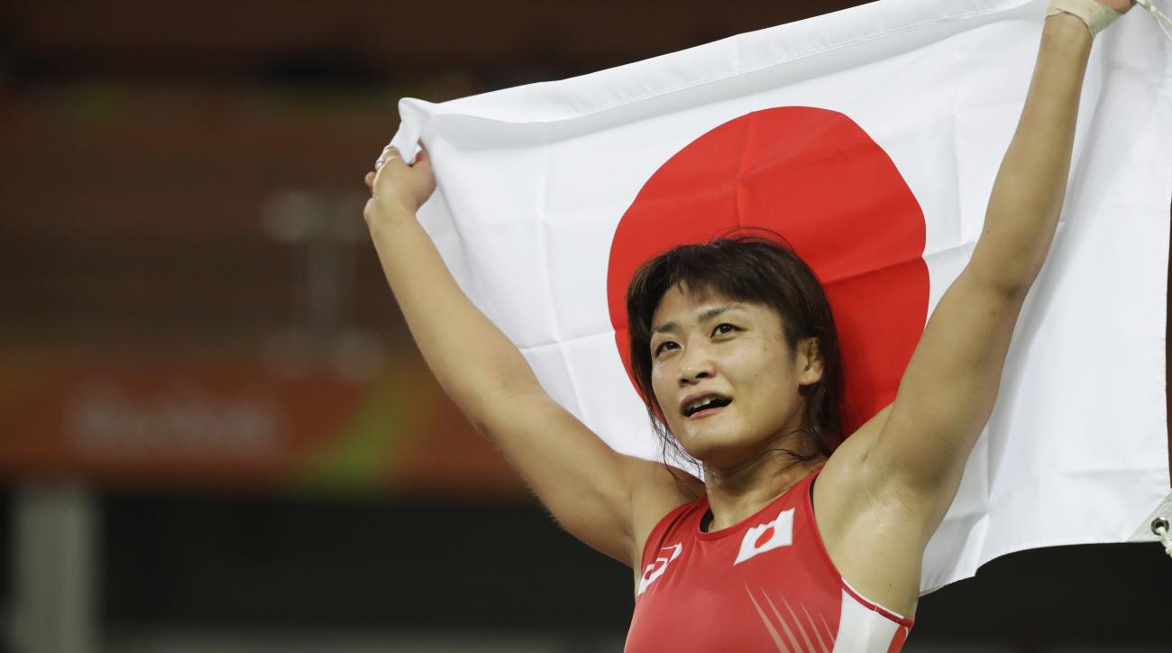 Japan's Kaori Icho celebrates winning gold against Russia's Valeria Koblova in the women's wrestling freestyle 58-kg competition at the the 2016 Summer Olympics in Rio de Janeiro, Brazil, Wednesday, Aug. 17, 2016. (AP Photo/Markus Schreiber)