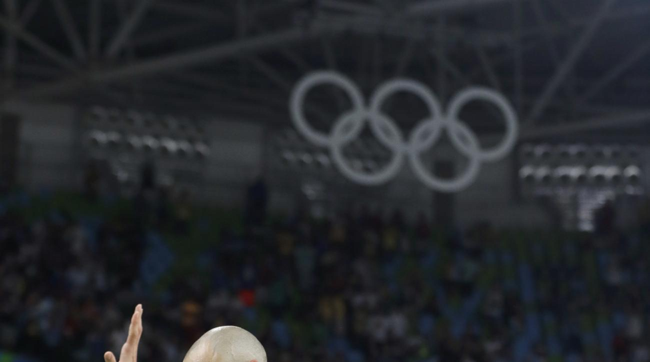 Argentina's Manu Ginobili (5) walks off the court with a game ball after the team's loss to United States in a men's quarterfinal round basketball game at the 2016 Summer Olympics in Rio de Janeiro, Brazil, Wednesday, Aug. 17, 2016. (AP Photo/Eric Gay)