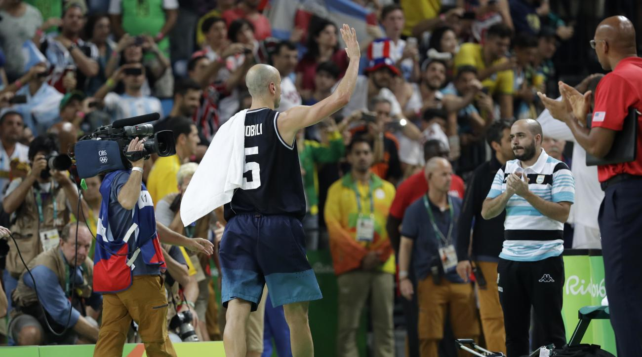 Argentina's Manu Ginobili (5) waves to fans as he leaves the court after a quarterfinal round basketball game against the United States at the 2016 Summer Olympics in Rio de Janeiro, Brazil, Wednesday, Aug. 17, 2016. (AP Photo/Charlie Neibergall)