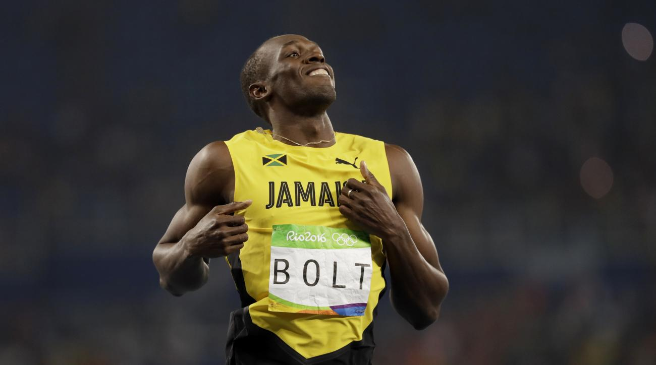 Jamaica's Usain Bolt wins a men's 200-meter semifinal during the athletics competitions of the 2016 Summer Olympics at the Olympic stadium in Rio de Janeiro, Brazil, Wednesday, Aug. 17, 2016. (AP Photo/David J. Phillip)