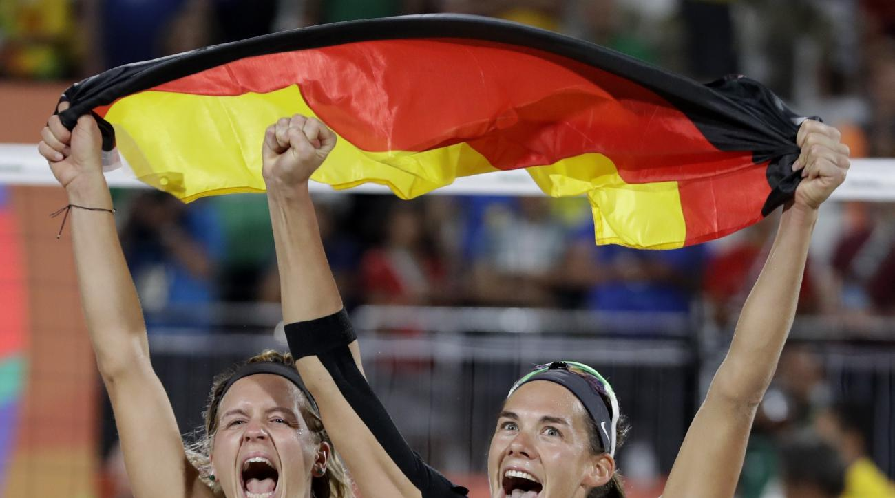 Germany's Laura Ludwig and teammate Kira Walkenhorst celebrate after defeating Brazil in the women's beach volleyball gold medal match of the 2016 Summer Olympics in Rio de Janeiro, Brazil, Thursday, Aug. 18, 2016. (AP Photo/Petr David Josek)