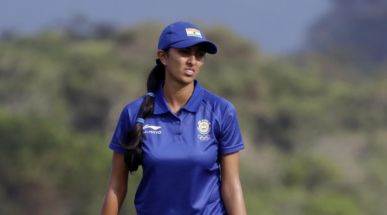 Aditi Ashok of India, watches her putt on the 3rd hole during the second round of the women's golf event at the 2016 Summer Olympics in Rio de Janeiro, Brazil, Thursday, Aug. 18, 2016. (AP Photo/Chris Carlson)