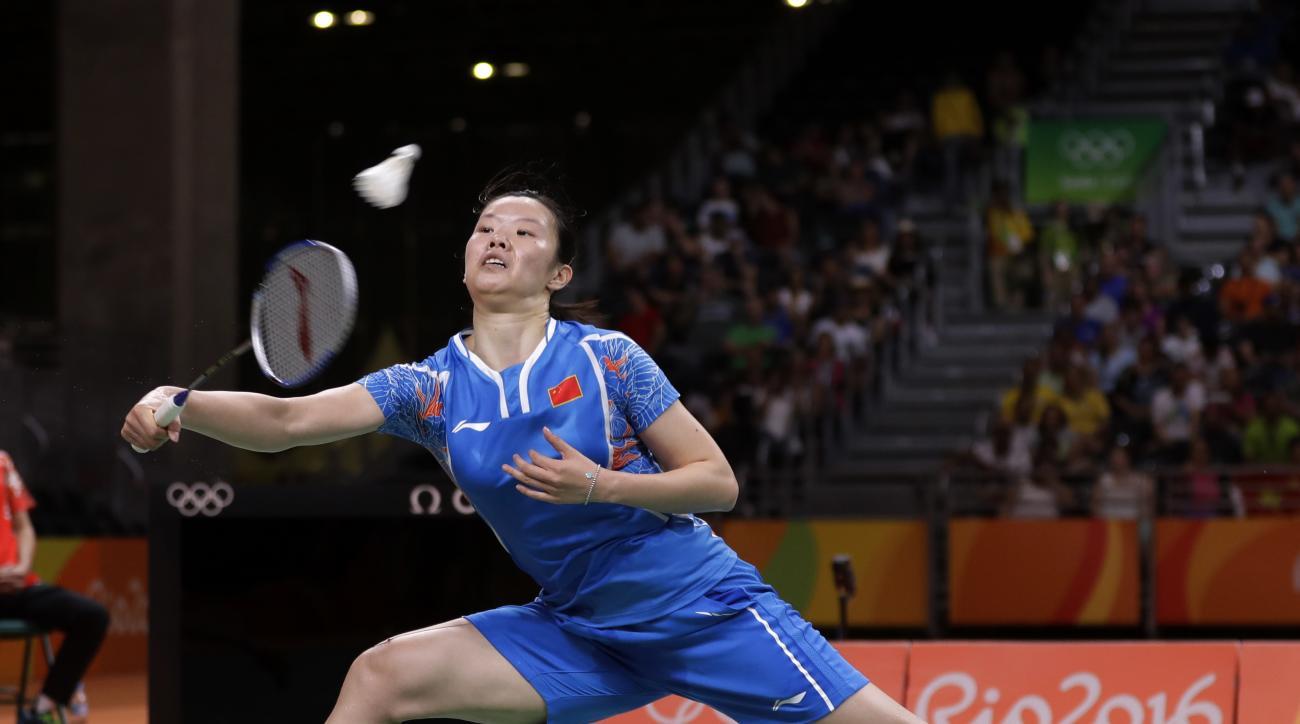 China's Li Xuerui plays against Spain's Carolina Marin during a women's singles semifinal match at the 2016 Summer Olympics in Rio de Janeiro, Brazil, Thursday, Aug. 18, 2016. (AP Photo/Kin Cheung)