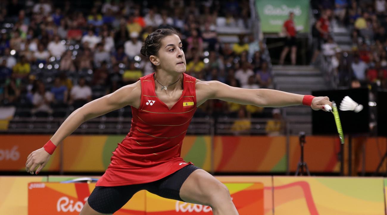 Spain's Carolina Marin plays against China's Li Xuerui during a women's singles semifinal match at the 2016 Summer Olympics in Rio de Janeiro, Brazil, Thursday, Aug. 18, 2016. (AP Photo/Kin Cheung)